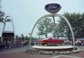 1965 Ford Mustang fastback in front the Ford Pavilion at the 1964 World's Fair in New York.